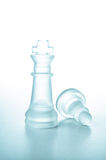 Winner and leadership concept. Glass chess piece king on a white background isolated Stock Image
