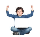 Winner little boy sitting with laptop. Isolated on white Royalty Free Stock Photo