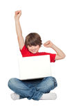 Winner little boy sitting with laptop. Isolated on white Stock Photography