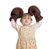 Winner little girl in boxing gloves Stock Photography