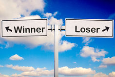 Winner or loser. Sign over the sky Stock Photography