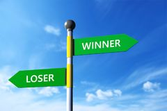 Winner and loser. In arrow sign board,sky background Stock Photography