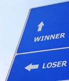 Winner loser signboard. Winner steps up, loser steps aside. Modified from road signboard (added words and arrow Stock Images
