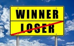 Winner and Loser. Winner versus Loser - road sign Royalty Free Stock Photography