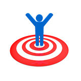 Winner. Man in blue stand on red circles Stock Photography