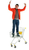 Winner man standing in shopping cart Stock Image