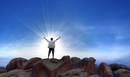 Winner man standing on the top of hill Royalty Free Stock Images