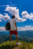 Winner. Man standing on top of mountain Royalty Free Stock Images