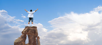 Winner man standing on the top of mountain Stock Image