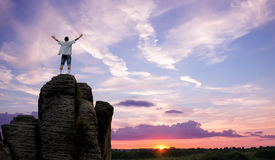 Winner man standing on the top of mountain panoramic view Royalty Free Stock Image