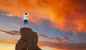 Winner man standing on the top of mountain panoramic view Royalty Free Stock Photos