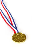 Winner Medal. On red white and blue ribbon isolated on white Royalty Free Stock Photography