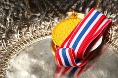 Winner medal with fabric neck holder ribbon. Winner medal with fabric neck holder ribbon scene Stock Photo