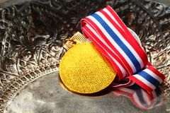 Winner medal with fabric neck holder ribbon. Winner medal with fabric neck holder ribbon scene Royalty Free Stock Photos