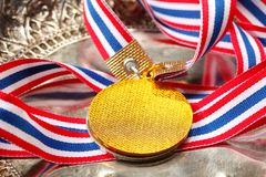 Winner medal with fabric neck holder ribbon. Winner medal with fabric neck holder ribbon scene Stock Photos