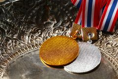 Winner medal with fabric neck holder ribbon. Winner medal with fabric neck holder ribbon scene Stock Photography