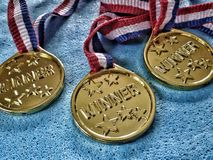Winner medals. Closeup view of three golden winner medals Royalty Free Stock Photography