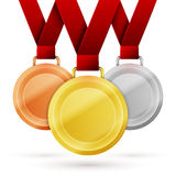 Winner medals. Set of winner medals with red ribbon isolated on white vector illustration