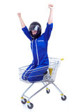 Winner motorcyclist in shopping cart Royalty Free Stock Image