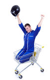 Winner motorcyclist  in shopping cart Royalty Free Stock Photo
