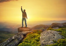 Winner on the mountain top Stock Images