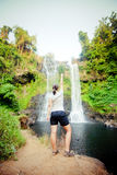 Winner near waterfall. Active life concept Royalty Free Stock Photos