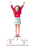 Winner on a podium. Isolated on a white background Royalty Free Stock Images