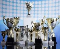 Sport podium, Cups of winners award. Winner podium sports symbols background Stock Image