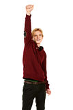 Winner pose. Young man standing with his hand raised up as the winner. Isolated over white Royalty Free Stock Photography