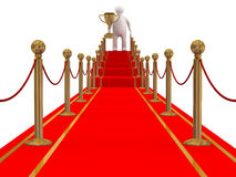 Winner on a red carpet path. Royalty Free Stock Images