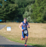 Winner. Richard Ebbage on his way to win the 2015 Vitruvian triathlon at Rutland Water on 29 august 2015 in a time of 4 hours 2 minutes royalty free stock photos