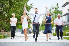 Winner while running with a business team Royalty Free Stock Photography