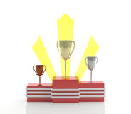 Winner's podium with cups Stock Images