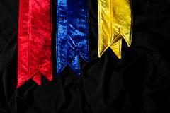 Winner Sash for Miss Pageant Beauty Contest. Red Yellow Blue Velvet Winner Sash for Miss Pageant Beauty Contest, empty area for text winner country word, studio royalty free stock photography