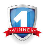 Winner shield with red ribbon Royalty Free Stock Photography