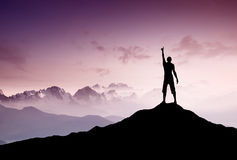 Winner silhouette. On the mountain top. Sport and active life concept Royalty Free Stock Photo