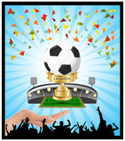 Winner soccer cup championship hold in the hand. Winner soccer cup championship on football field hold in the hand Stock Images