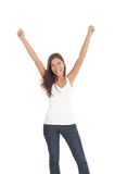 Winner / Success woman. Successful winning young woman with her arms up. Isolated on white background Royalty Free Stock Photography