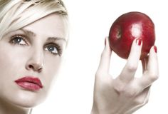 Winner takes all and apple. Portrait of blond with apple in the hand royalty free stock image