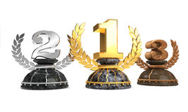 Winner. Three reflectiv metal trophies with marble base and white background Stock Photography
