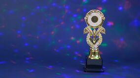 Winner trophy with bokeh in the background. Victory concept