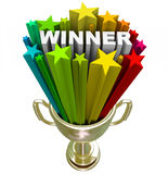 Winner Trophy - Burst of Stars Fireworks. A golden first place trophy with the word winner and colorful stars shooting out of it, symbolizing winning a royalty free illustration