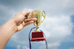 Winner trophy cup on sky background.  royalty free stock images