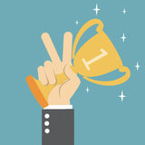 Winner trophy. Hand holding a winner trophy Royalty Free Stock Image