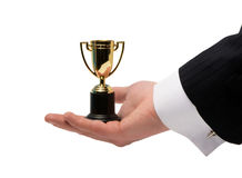 Winner trophy in his hand Royalty Free Stock Image