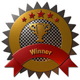 Winner Trophy Seal. A 3D metallic gold, red and chequered background seal with 5 stars and the text Winner in gold on a red metallic ribbon Stock Photo