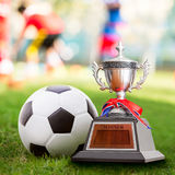 Winner trophy. And soccer ball at the competition sport court Royalty Free Stock Image