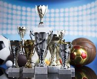 Sport podium, Cups of winners award. Winner trophy, Sport equipment and balls royalty free stock images