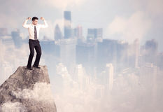 Winner urban businessman on top of stone Stock Images