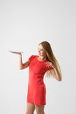 Winner woman excited holding tablet pc isolated on white background. Royalty Free Stock Photography
